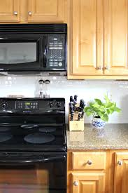 peel and stick backsplash tiles on tv and mags smart tiles smart tile backsplash model ten june how to update a rental kitchen with peel and stick tile model