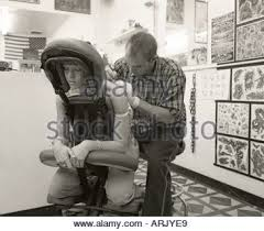 amy crawford getting a tattoo from tattoo artist chuck gilmore in