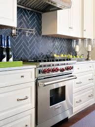 dark stone backsplash kitchen white backsplash white cabinets grey stone backsplash