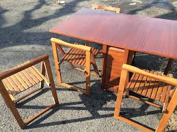 table and chairs with storage gateleg table with four storeable chairs attainable vintage