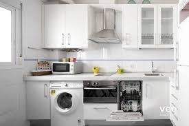 cuisine avec lave linge appartement rue verde séville espagne macarena terrasse