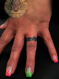 modern wedding ring finger tattoo design tattoomagz