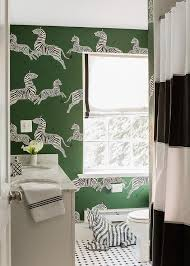 green and black bathroom with black striped shower curtain