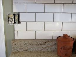 plain white subway tile grey grout of kitchen backsplash l for