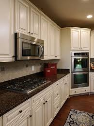 white kitchen cabinets with antique brown granite pin by gülcihan on home decor antique white kitchen