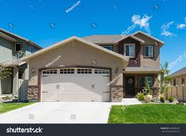 Level House by Contemporary Splitlevel House Garage Front Stock Photo 449308285