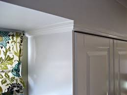 then we added crown molding and painted it benjamin moore simply