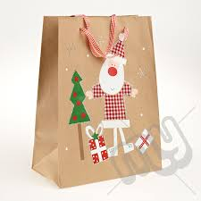 christmas paper bags santa clause kraft paper christmas gift bag with glitter detail