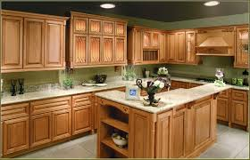 cream colored kitchen cabinets with black appliances home design