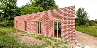 Exterior Wall Design Triangular House Design And Floor Plan Idea With Perforated Bricks