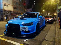mitsubishi evo spoiler spotted a wide body evo x with a huge spoiler at the back 3 images