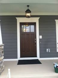front door with windows blue color of house with white trim