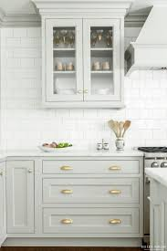 flat front kitchen cabinets marble countertops light gray kitchen cabinets lighting flooring