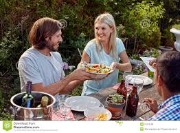group friends enjoying outdoor dinner party stock photos images