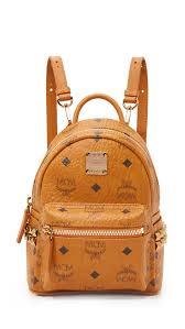 mcm designer shop mcm side stud baby stark backpack in cognac at modalist