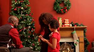 decorating christmas tree family decorating christmas tree together stock footage