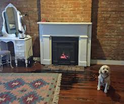 senator gas fireplace with cast iron front fits very small spaces