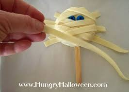 mummy pops rice krispies treat lollipops for halloween hungry