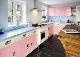 kitchen 1950s vibe kitchen features white and pastel pink cabinets