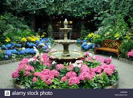 indoor garden of lilies and hydrangea with fountains at the stock