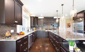 what color countertops go with brown cabinets quartz vs granite which is best all about countertops