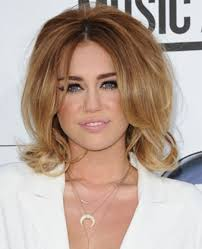 whats the name of the haircut miley cyrus usto have cyrus retro short curly hairstyle with volume