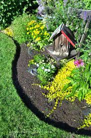 how to edge flowerbeds like a pro via funky junk interiorsfunky