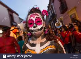 halloween in mexico a mexican woman dressed in costumes with face paint parade through
