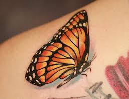 flying butterfly tattoos artists usually show their creativity by