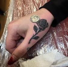 best 25 rose tattoo on hand ideas on pinterest rose hand tattoo
