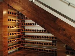 attractive custom under staircase wine cellar with glass door