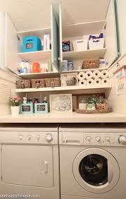 Laundry Room Storage Between Washer And Dryer by How To Completely Organize Your Laundry Room In Three Easy Steps