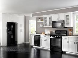 Light Grey Kitchen Walls by Black Appliances White Light Grey Cabinets And Darker Grey Walls