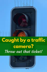 traffic light camera ticket caught by a traffic camera throw away that ticket i pick up pennies