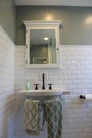 bathroom with using white subway tiles ideas marble countertop and bathroom with using white subway tiles ideas rectangular popular wooden drawer smooth cotton towel