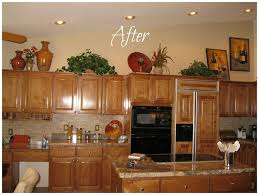 top of kitchen cabinet decorating ideas decorating above kitchen cabinets for