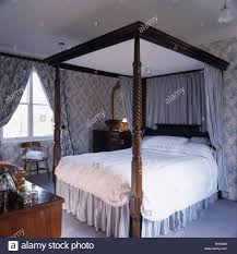 Four Poster Bed Curtains Drapes Four Poster Bed With Pastel Blue Drapes And White Bedlinen In