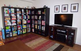 l black wood book shelf room divider with some cube shelves