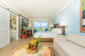 Home Design Concept With Beach Background Photo 1 by Margaritaville Beach Resort Grand Cayman Hotel