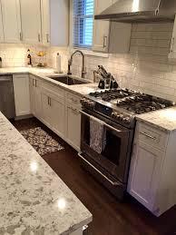 white shaker kitchen cabinets with white subway tile backsplash white kitchen gain inspiration and view lewis floor