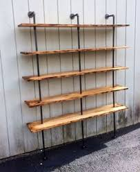 Wood Bookshelves by Reclaimed Wood And Pipe Shelving Unit Reclaimed Wood Wall Shelf