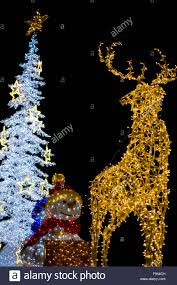 yellow deer with snowman and white christmas tree decoration