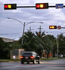 ran a red light camera if your car is in the intersection and the stop light turns red