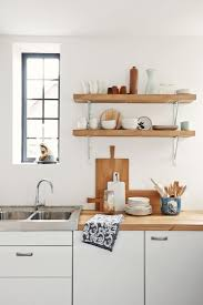 unstained kitchen cabinets simple unstained oak wood floating shelves on white painted wall