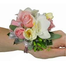 pink corsage light pink spray and freesia wristlet corsage