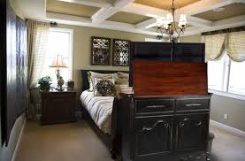 tv lift cabinet foot of bed tv lift cabinets that disguise your electronics as elegant furniture