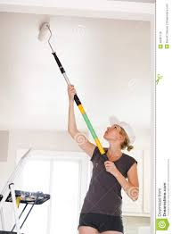 closeup woman painting ceiling stock photo image 45097156