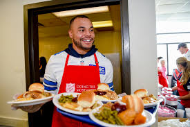 cowboys get timely perspective during salvation army thanksgiving