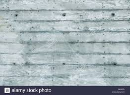 texture of board formed concrete wall showing wood grain and