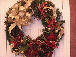 a poinsettia and pine cone wreath would look wonderfully festive